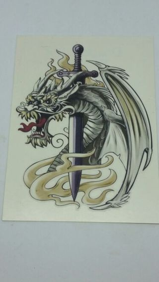 Gray dragon with sword temporary tattoo