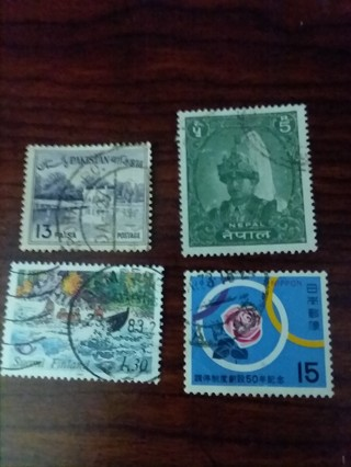 Four used stamps- worldwide