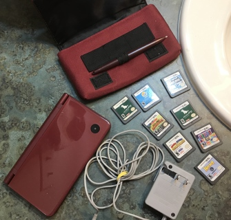 Nintendo DSi XL Red, Charger, 8 Games, Stylus Pen & Carrying Case