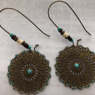 Beautifully Designed Dangling Earrings .