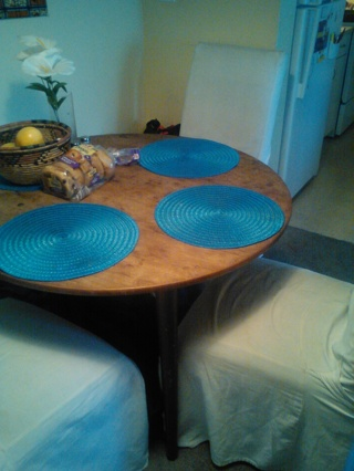 ROUND TABLE WITH EXTENDER and  4 CHAIRS