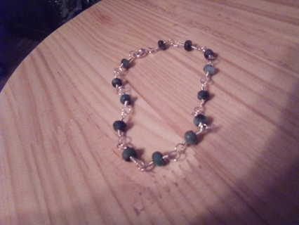 Emeralds and silver bracelet