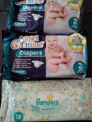 New. size 2 diapers by angel of mine.total of 12 diapers and travels size wipes