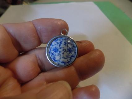Glass domed pendant charm & blue flower on white background