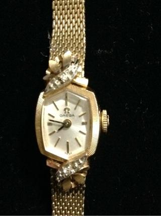 Vintage 14k gold diamond omega ladies wristwatch