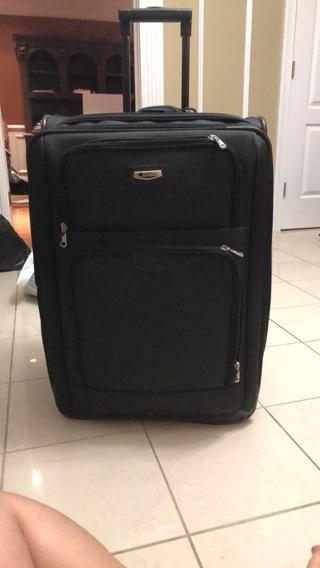 Delsey large black suitcase