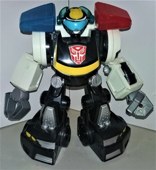 "2010 Hasbro all-plastic talking large POLICE action figure - ON/OFF switch - size 9"" tall x 9"" wide"