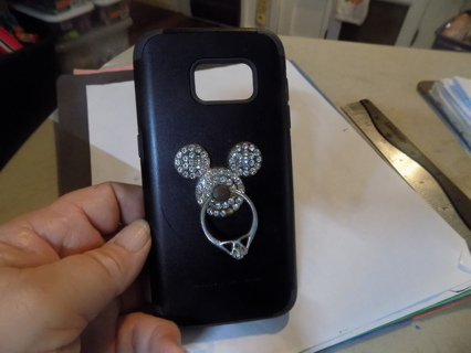 Black body glove phone case with rhinestone covered Mickey Mouse kickstand