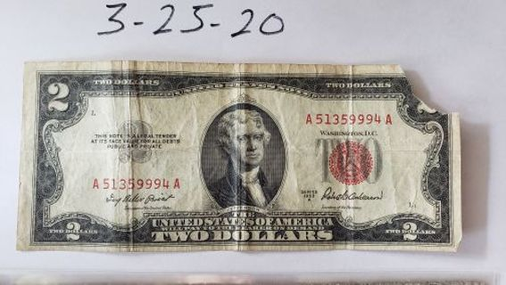 1953-A Red Seal Two Dollar bill. (Missing Corner) creased and worn.