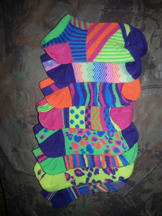 4 pair brand new mix match kids socks never worn. The package said size 6 but are smaller than that.