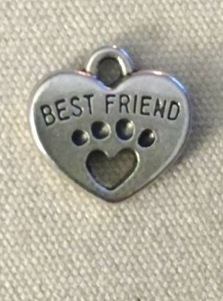My best friend dog paw heart silvertone charm. Use the get it now option and get free surprise.