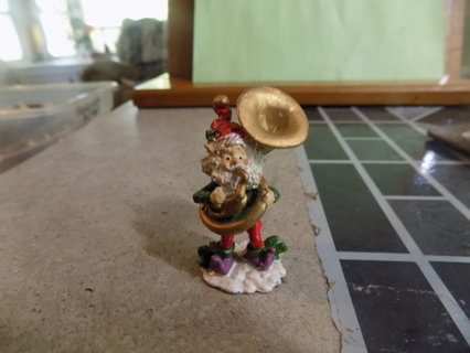 Die cast metal elf playing tuba