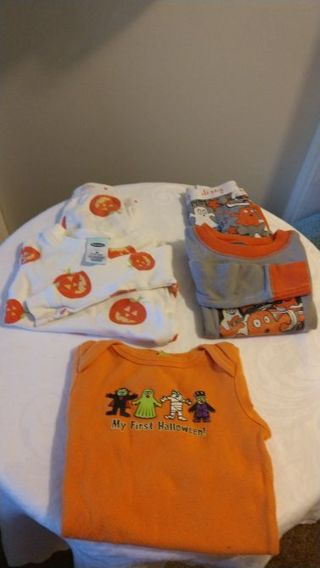 Babies Halloween pajamas and onesie 6 to 9 months and 6 to 12 months. Free shipping
