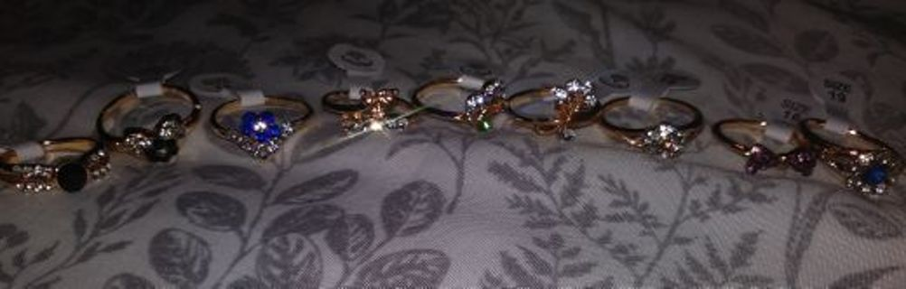 All new 10 womens gold plated rings bows hearts etc... Sizes 6, 7, 8, & 9