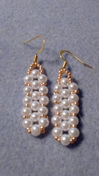 Hand made pearl and gold beaeded earrings
