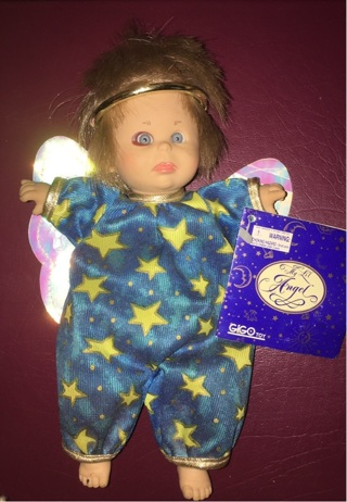 The Lil Angel doll 8 inches tall has one eye smaller  has a miner mistake.