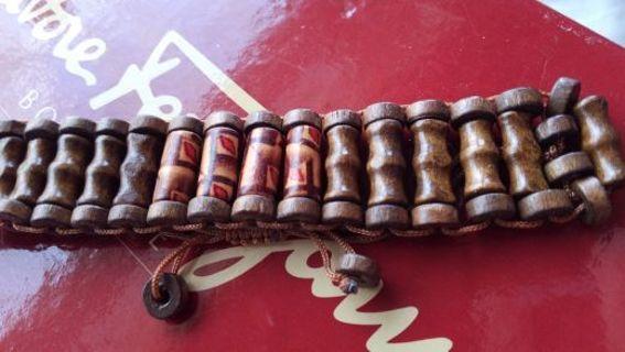 Pair of carved wooden bracelets, adjustable size