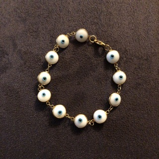 Bracelet with eyes as charms
