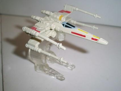 """2014 Mattel LFL Star Wars miniature plastic X-Wing Fighter on pedestal - size 3"""" long X 2 3/4"""" high"""
