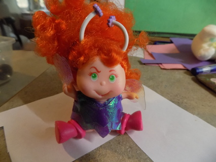 REd curly haired fairy baby.  Made of hard rubber 4 inch tall