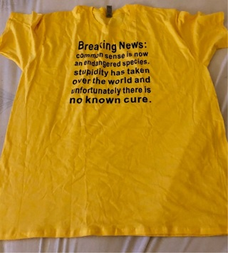 """Brand New 3XL Yellow Funny T Shirt. """"BREAKING NEWS: Common Sense Is Now An Endangered...."""""""