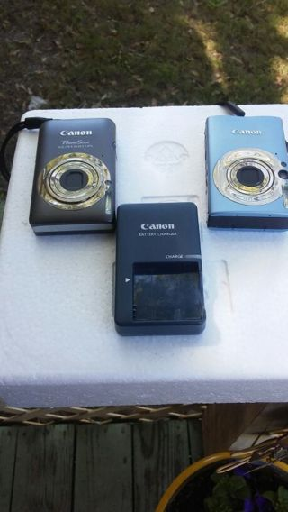2 CANON CAMERAS & CHARGER
