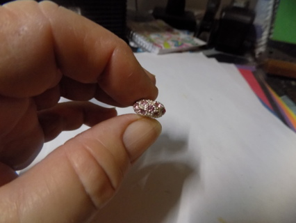 Silvertone slider bead covered in pink rhinestones