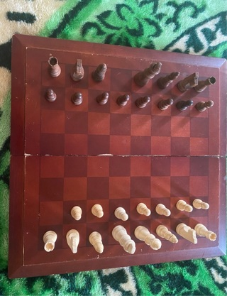 Wooden folding game board with pieces