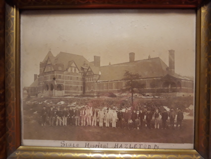 Old picture in frame of The Hazelton, PA state Hospital.
