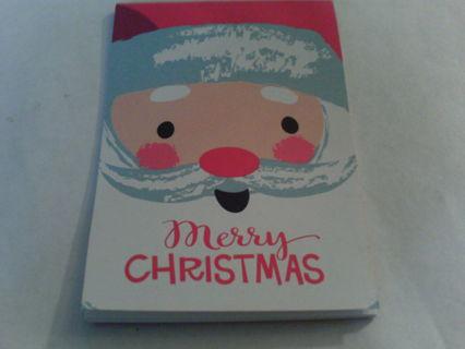 Santa - small pad of paper.