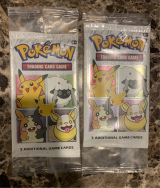 2 packs of Pokémon cards 3 cards per pack