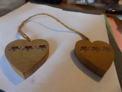 2 cut out wooden hearts with red heart shape flower