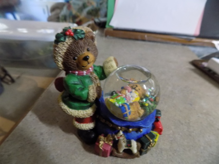 Resin textured Teddybear dressed as Santa in green suit mini toy bag snowglobe