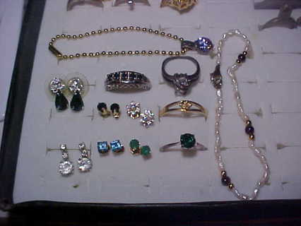 NICE LOT OF RINGS AND EARRINGS REAL? DONT KNOW