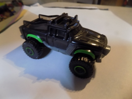 Black plastic 3 inch pick up truck with lime green wheel wheels