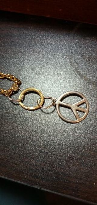 Peace sign with brass circle soldered with silver