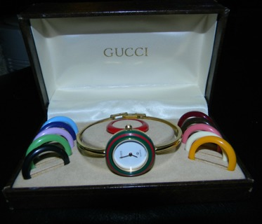 66a028ca060 Free  Ladies VINTAGE GUCCI Gold Plated Bangle Watch with 12 Benzels ...