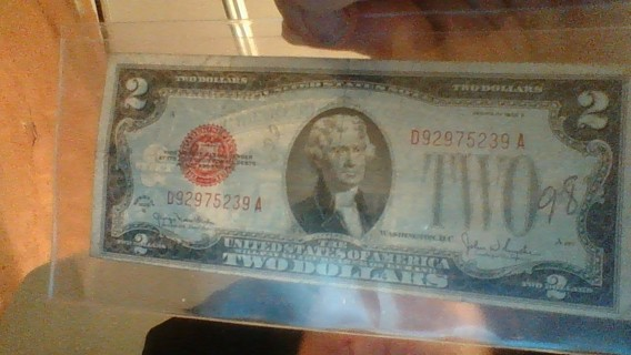 here is and oldy 1928 g two dollar bill