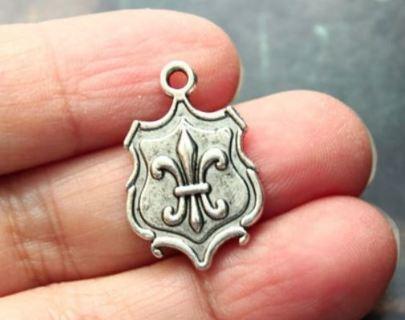 Two Fleur de lis shield pendants