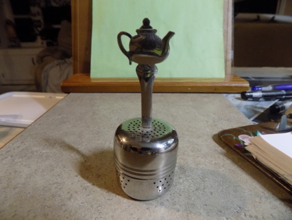 Stainless steel tea diffuser has tea pot on handle # 1