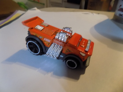Hot Wheels Orange Low Rider Fire Truck with engine sticking out and pipes on side