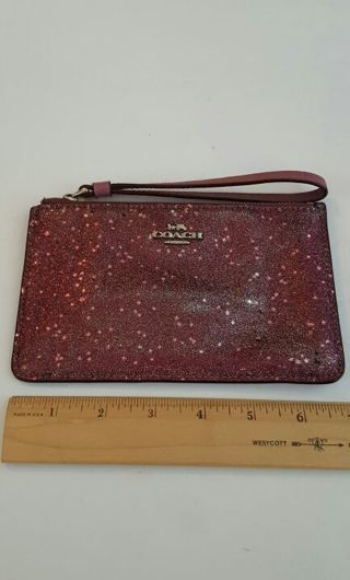Coach Wristlet Glittery stars used lots of fading on the front please see all pics
