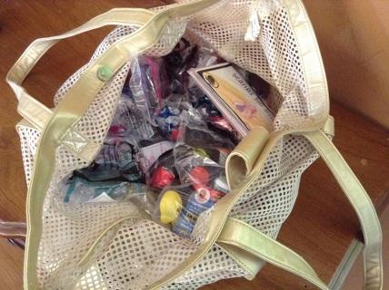 McDonald's toys stuffed in beach bag