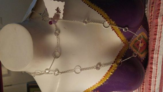 New with tags Kim Rogers long Silvertone and clear crystal necklace from major dept stores.