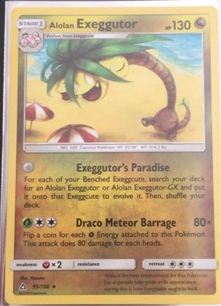 Alolan Exeggutor pokemon card with sleeve