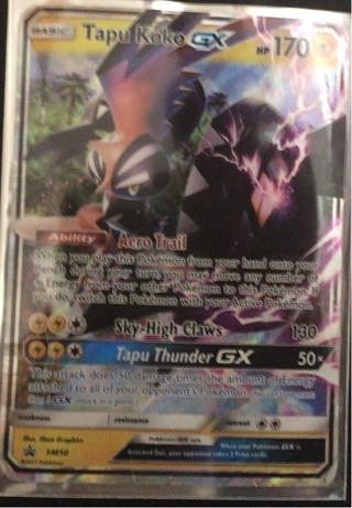 Tapu Koko GX pokemon card, with sleeve