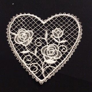 One lace heart with flower