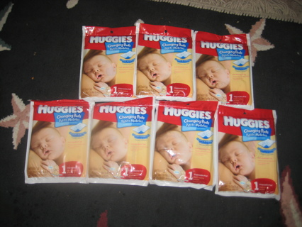 ALL SEVEN HUGGIES DISPOSABLE CHANGING PADS BRAND NEW IN PACKING!!!!
