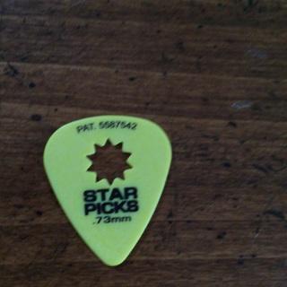 Yellow star guitar pick