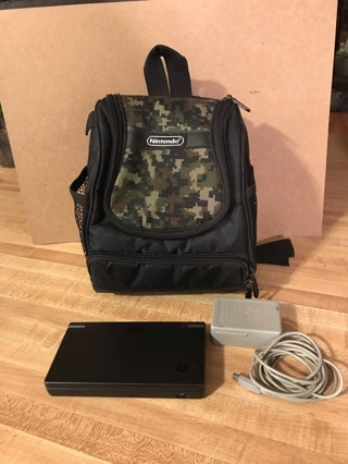 Nintendo DSi Console w/ charger and backpack
